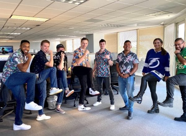 Dressed in Hawaiian print and fancy shoes, the product team at ReliaQuest looks forward to each Friday as a way to enjoy the last day of the work week and wear something out of the ordinary business casual dress code.